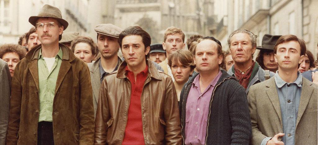 Jean-Louis Rolland, Richard Berry et Jean-François Stévenin, dans le film Une chambre en ville de Jacques Demy, 1982. Photographie : Moune Jamet © 2008 Ciné-Tamaris